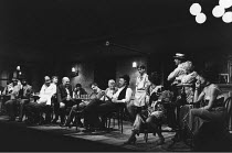 THE ICEMAN COMETH   by Eugene O^Neill   design: Hayden Griffin   lighting: Andy Phillips   director: Bill Bryden ,front, l-r: Oscar James (Joe Mott), Frederick Treves (Cecil Lewis / The Captain), Bria...