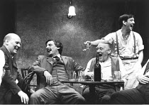 THE ICEMAN COMETH   by Eugene O^Neill   design: Hayden Griffin   lighting: Andy Phillips   director: Bill Bryden ,seated, front, l-r: Brian Glover (Pat McGloin), Jack Shepherd (Theodore Hickman / Hick...