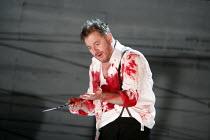 MACBETH  by Verdi  after Shakespeare  conductor: Richard Farnes  set design: Johan Engels  costumes: Brigitte Reiffenstuel  director: Tim Albery ~Robert Hayward (Macbeth) ~Opera North, Leeds, England...