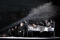 MACBETH  by Verdi  after Shakespeare  conductor: Richard Farnes  set design: Johan Engels  costumes: Brigitte Reiffenstuel  director: Tim Albery ~Macduff places a branch from Birnam wood on the bed co...