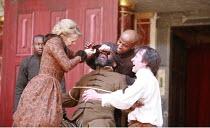 KING LEAR   by Shakespeare   design: Jonathan Fensom   director: Dominic Dromgoole <br>,III/vii - the blinding of Gloucester - l-r: Kellie Bright (Regan), Joseph Mydell (Gloucester), Beru Tessema (Fra...