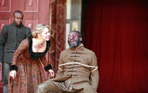 KING LEAR   by Shakespeare   design: Jonathan Fensom   director: Dominic Dromgoole <br>,III/vii - the blinding of Gloucester: Kellie Bright (Regan), Joseph Mydell (Gloucester),Shakespeare^s Globe (SG)...