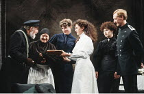THREE SISTERS   by Anton Chekhov   design: Paul Dart   translated & directed by: Mike Alfreds <br>,l-r: Rex Doyle (Ferapont), Sandra Voe (Anfisa), Holly Wilson (Olga), Chloe Salaman (Irina), Leslee Ud...