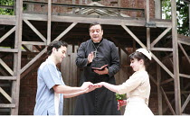 ROMEO AND JULIET   by Shakespeare   set design: Robert Innes Hopkins   costumes: Fotini Dimou   director: Timothy Sheader <br>,the Friar marries the lovers - l-r: Nicholas Shaw (Romeo), Richard O^Call...