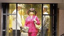 ARIADNE AUF NAXOS   by Richard Strauss   conductor: Mark Elder   design: Herbert Murauer   lighting: Jennifer Tipton   director: Christof Loy ~in the elevator: Wolfgang Barta (The Major Domo), Deborah...
