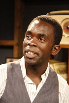 Jimmy Akingbola (Jimmy Porter) in LOOK BACK IN ANGER by John Osborne at the Jermyn Street Theatre, London SW1  02/07/2008  design: Marialena Kapotopoulou   director: Alexander Gilmour