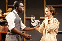 Jimmy Akingbola (Jimmy Porter), Laura Dos Santos (Alison Porter) in LOOK BACK IN ANGER by John Osborne at the Jermyn Street Theatre, London SW1  02/07/2008  design: Marialena Kapotopoulou   director:...