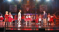 HIGH SCHOOL MUSICAL - LIVE ON STAGE   director: Jeff Calhoun ~front left: Letitia Dean (Ms Darbus), Claire-Marie Hall (Gabriella Montez), Mark Evans (Troy Bolton)   right: Norman Bowman (Coach Bolton)...