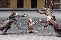 TIMON OF ATHENS   by Shakespeare   design: William Dudley   director: Lucy Bailey ~l-r: Jonathan Bond (Bandit), Simon Paisley Day (Timon of Athens), (rear) Adam Burton (Bandit), Sam Parks (Bandit)~Sha...