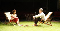 THE NORMAN CONQUESTS - ROUND AND ROUND THE GARDEN   by Alan Ayckbourn   ~design: Rob Howell   lighting: David Howe   director: Matthew Warchus  ~Amelia Bullmore (Ruth), Ben Miles (Tom)~Old Vic Theatre...
