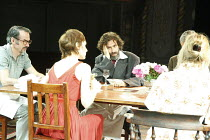 THE NORMAN CONQUESTS - TABLE MANNERS   by Alan Ayckbourn   design: Rob Howell   lighting: David Howe   director: Matthew Warchus ~from left: Paul Ritter (Reg), Amelia Bullmore (Ruth), Stephen Mangan (...