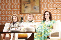 ABSENT FRIENDS   by Alan Ayckbourn   design: Emma Wee   director: Brigid Larmour ~l-r: Sally Ann Triplett (Marge), Jonathan Guy Lewis (Paul), Abigail Thaw (Diana)~Watford Palace Theatre, Watford / Eng...