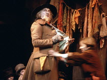 OLIVER!   by Lionel Bart   after 'Oliver Twist' by Dickens design: Sean Kenny   director: Peter Coe   'Got to pick a pocket or two': Ron Moody (Fagin) Aldwych Theatre, London WC2                 20/...