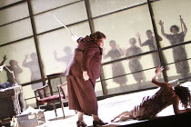 ELEKTRA   by Richard Strauss   conductor: Mark Elder   set design & direction: Charles Edwards   costumes: Brigitte Reifenstuel ~Miriam Murphy (Overseer) threatens Fifth Maid~The Royal Opera (RO) / Co...