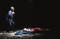 THE THEBANS   by Sophocles   in a new translation by Timberlake Wertenbaker   design: Ultz   director: Adrian Noble ~part iii - ANTIGONE: John Shrapnel (Creon) with the bodies of Haemon & Eurydice ~Ro...
