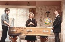 LOOT   by Joe Orton   design: Saul Radomsky   lighting: Mick Hughes   director: Jonathan Lynn   l-r: Neil Pearson (Hal), Gemma Craven (Nurse Fay), Paul McGann (Dennis) Ambassador's Theatre, London...