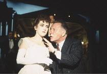 AN INSPECTOR CALLS   by J B Priestley   design: Ian MacNeil   director: Stephen Daldry ~~Sylvestra Le Touzel (Sheila Birling), Kenneth Cranham (Inspector Goole)~National Theatre production / Aldwych T...