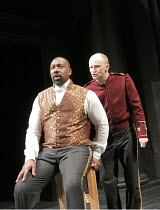OTHELLO by Shakespeare  set design: Ruari Murchison  costumes: Stephen Snell  lighting: Guy Hoare  director: Barrie Rutter ~sowing the seeds of doubt - l-r: Lenny Henry (Othello), Conrad Nelson (Iago)...