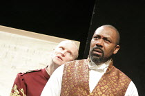 OTHELLO by Shakespeare  set design: Ruari Murchison  costumes: Stephen Snell  lighting: Guy Hoare  director: Barrie Rutter ~l-r: Conrad Nelson (Iago), Lenny Henry (Othello)~a Northern Broadsides & Wes...