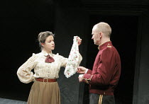 OTHELLO by Shakespeare  set design: Ruari Murchison  costumes: Stephen Snell  lighting: Guy Hoare  director: Barrie Rutter ~Maeve Larkin (Emilia), Conrad Nelson (Iago) ~a Northern Broadsides & West Yo...