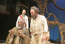 THE TEMPEST   by Shakespeare   design: Illka Louw   lighting: Mannie Manim   director: Janice Honeyman   l-r: (front) John Kani (Caliban), (rear) Lionel Newton (Antonio), Antony Sher (Prospero) Bax...
