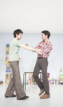 OVER THERE   by Mark Ravenhill   set design: Johannes Schutz   costumes: Iona Kenrick   ~lighting: Matt Drury   directors: Ramin Gray & Mark Ravenhill ~l-r: Luke Treadaway (Karl), Harry Treadaway (Fra...