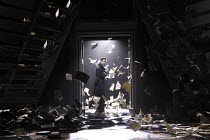 THE WINTER'S TALE   by Shakespeare   design: Jon Bausor   lighting : Jon Clark   director: David Farr ~the storm - books and papers falling, blowing in the wind: Greg Hicks (Leontes)~Royal Shakespeare...