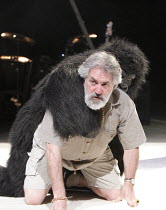 PEER GYNT   by Ibsen   adapted by Colin Teevan   ~design: Naomi Wilkinson   lighting: Chris Davey   director: Dominic Hill ~Gerry Mulgrew (Old Peer) with gorilla~National Theatre of Scotland & Dundee...