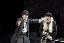 WAITING FOR GODOT   by Samuel Beckett   design: Stephen Brimson Lewis   lighting: Paul Pyant   director: Sean Mathias ~~l-r: Patrick Stewart (Vladimir), Ronald Pickup (Lucky) ~Theatre Royal Haymarket...