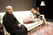 GRASSES OF A THOUSAND COLOURS   by Wallace Shawn   design: Eugene Lee   lighting: Howard Harrison   director: Andre Gregory   l-r: Wallace Shawn (The Memoirist / Ben), Emily McDonnell (Rose), Miranda...