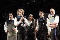 ALL'S WELL THAT ENDS WELL   by Shakespeare   design: Rae Smith   lighting: Peter Mumford   director: Marianne Elliott ~Parolles with young lords - l-r: Tom Padley, Alex Felton, Conleth Hill (Parolles)...