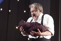 THE WINTER'S TALE   by Shakespeare   set design: Anthony Ward   costumes: Catherine Zuber   lighting: Paul Pyant   director: Sam Mendes ~Leontes holds Hermione's baby: Simon Russell Beale (Leontes)...