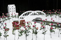 THE IMPORTANCE OF BEING EARNEST   by Oscar Wilde   design: Kevin Knight   director: Irina Brown ~set (detail)   flowers   book   house   bridge~Open Air Theatre (OAT) / Regent's Park, London NW1    08...