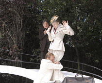 THE IMPORTANCE OF BEING EARNEST   by Oscar Wilde   design: Kevin Knight   director: Irina Brown ~l-r: Richard O'Callaghan (Rev. Canon Chasuble), Dominic Tighe (Algernon Moncrieff), Julie Legrand (Miss...