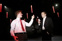 ENRON   by Lucy Prebble   design: Anthony Ward   lighting: Mark Henderson   director: Rupert Goold ~Fastow explains the scam to Skilling - l-r: Tom Goodman-Hill (Andy Fastow), Samuel West (Jeffrey Ski...