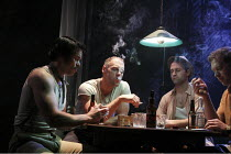 A STREETCAR NAMED DESIRE   by Tennessee Williams   design: Christopher Oram   lighting: Neil Austin   director: Rob Ashford ~the poker game - l-r: Luke Rutherford (Pablo), Elliot Cowan (Stanley Kowals...