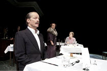 TABLE NO. 7 - SEPARATE TABLES   by Terence Rattigan   design: Stephen Brimson-Lewis   lighting: Paul Pyant   director: Philip Franks ~l-r: Deborah Findlay (Miss Cooper), Iain Glen (Major Pollock), Ste...