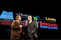 THE POWER OF YES   by David Hare   design: Bob Crowley   lighting: Paule Constable   director: Angus Jackson ~l-r: Anthony Calf (The Author), Simon Williams (Harry Lovelock)  ~Lyttelton Theatre / Nati...