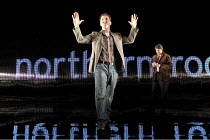 THE POWER OF YES   by David Hare   design: Bob Crowley   lighting: Paule Constable   director: Angus Jackson ~l-r: John Hollingworth (A Northern Echo journalist), Anthony Calf (The Author)~Lyttelton T...