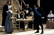 THE CRUCIBLE   by Arthur Miller   design: William Dudley   lighting: Chris Parry   director: Howard Davies ~front: Zoe Wanamaker (Elizabeth Proctor), Paul Shelley (Deputy-Governor Danforth)~Olivier Th...
