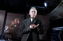 THE KREUTZER SONATA   by Tolstoy   adapted by Nancy Harris   design: Chloe Lamford   lighting: Mark Howland   director: Natalie Abrahami   Hilton McRae (Pozdynshev) with (rear) Tobias Beer (Trukhache...