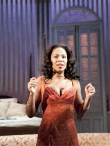 CAT ON A HOT TIN ROOF   by Tennesseee Williams   set design: Morgan Large   costumes: Fay Fullerton   lighting: David Holmes   director: Debbie Allen ~Sanaa Lathan (Maggie) ~Novello Theatre, London WC...