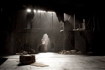 KING LEAR   by Shakespeare   design: Jon Bausor   lighting: Jon Clark   director: David Farr ~stage   set   empty   (with Gloucester & Edgar in background)~Royal Shakespeare Company (RSC) / Courtyard...