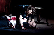 TOSCA   by Puccini   conductor: Gianluca Marciano   design: Peter McKintosh   lighting: Peter Mumford   director: Lindsay Posner   end of Act 2, Tosca with dead Scarpia: Claire Rutter (Tosca), Robert...