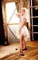 LULU   by Frank Wedekind   adapted & directed by Anna Ledwich   design: Helen Goddard   lighting: Emma Chapman ~posing for the artist Schwartz: Sinead Matthews (Lulu) ~Gate Theatre Notting Hill & Head...