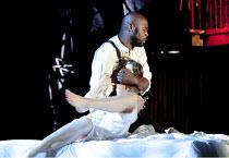 OTHELLO  by Shakespeare  design: Philip Witcomb  lighting: John Tapster  director: Ben Crocker  Othello kills Desdemona: Christopher Obi (Othello), Emily Pennant-Rea (Desdemona) Ludlow Festival, Lud...