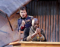 OTHELLO  by Shakespeare  design: Philip Witcomb  lighting: John Tapster  director: Ben Crocker ~sowing the seeds of doubt - l-r: Michael Mueller (Iago), Christopher Obi (Othello)~Ludlow Festival, Ludl...