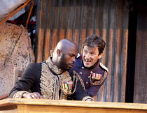 OTHELLO  by Shakespeare  design: Philip Witcomb  lighting: John Tapster  director: Ben Crocker ~sowing the seeds of doubt - l-r: Christopher Obi (Othello), Michael Mueller (Iago)~Ludlow Festival, Ludl...