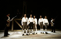 DANTON'S DEATH  by Georg Buchner  in a new version by Howard Brenton  design: Alison Chitty  lighting: Stephen Wentworth  director: Peter Gill <br> ~centre, l-r: Paul Moriarty (Lacroix), Anthony Higgi...