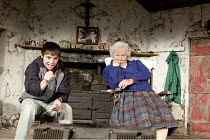 THE BEAUTY QUEEN OF LEENANE   by Martin McDonagh   design: Ultz   lighting: Charles Balfour   director: Joe Hill-Gibbins ~Terence Keeley (Ray Dooley), Rosaleen Linehan (Mag Folan) ~The Young Vic (YV),...